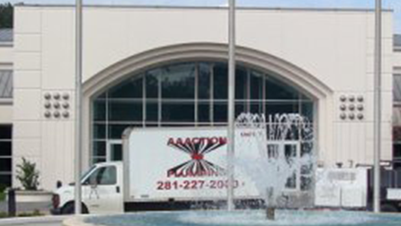 Company Truck Behind a Fountain